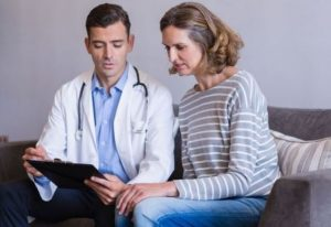 Doctor with his patient in a regular health assessment session, Health check in Adelaide