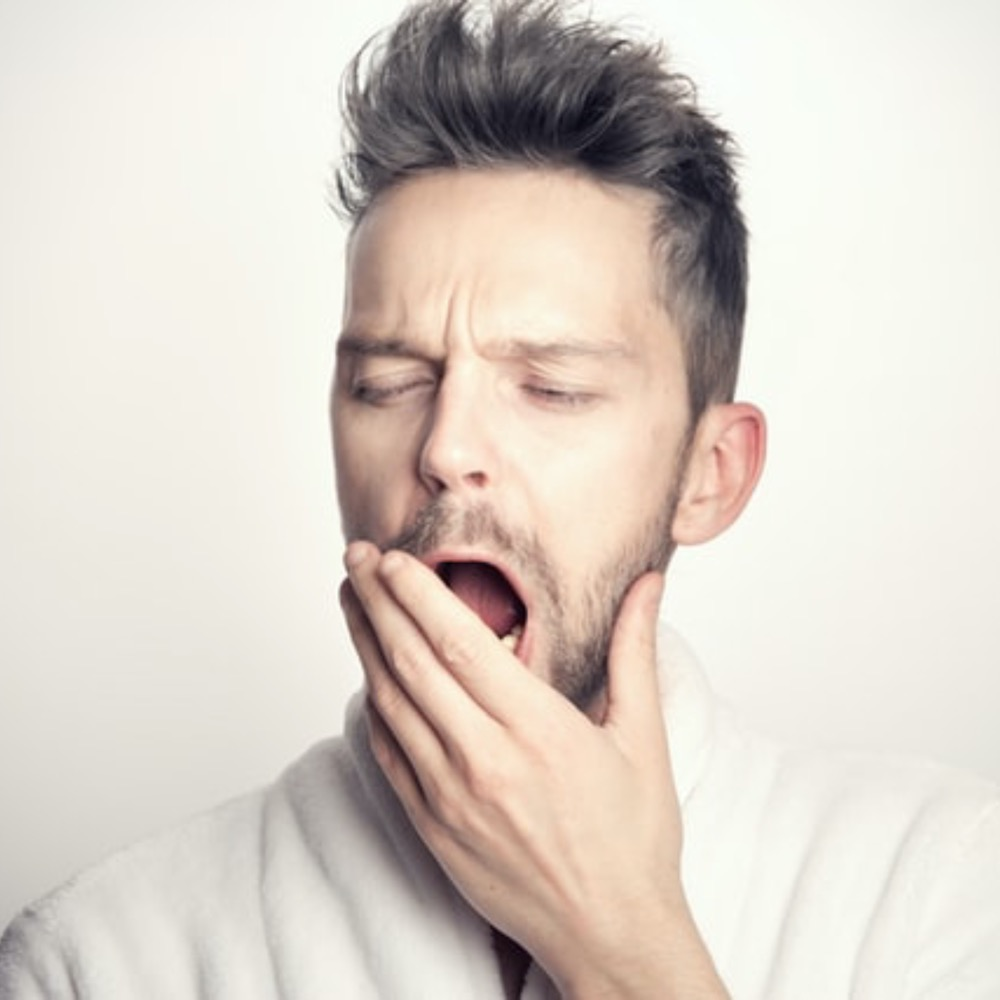 A man yawning due to exhaustion due to iron deficiency, Iron Deficiency GP in Adelaide